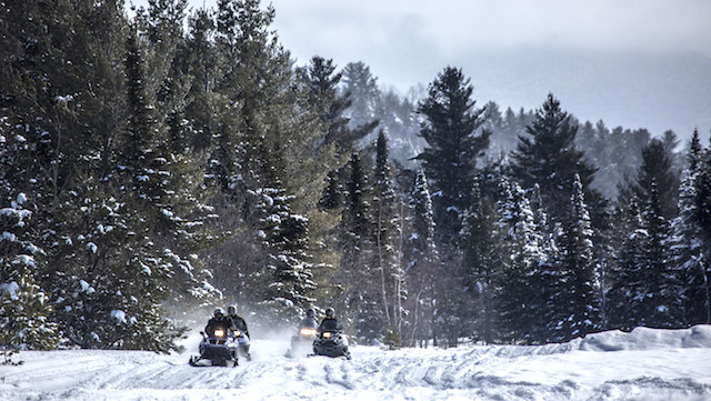 Snowmobiling on a corridor trail in the Adirondacks.