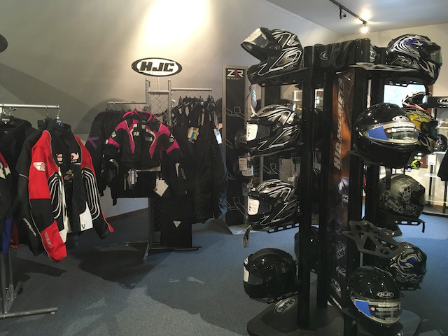 Snowmobile jackets and helmets at Village Motors in Speculator.